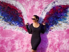 Christina Cindrich in front of angel wings on Melrose