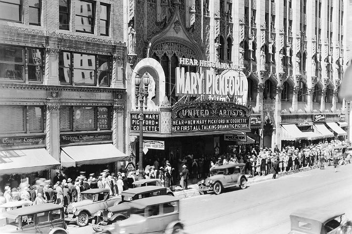 "Crowds line up for Mary Pickford's first talkie, ""Coquette"" at the United Artists Theatre"