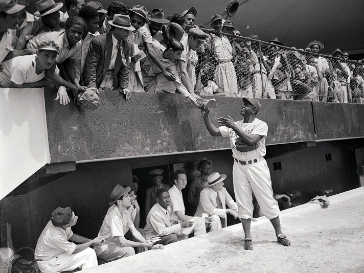 "Photo of Jackie Robinson signing autographs, from ""Chasing Dreams"" at Skirball Cultural Center"