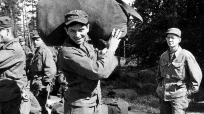 Bill Graham stands in his Army fatigues