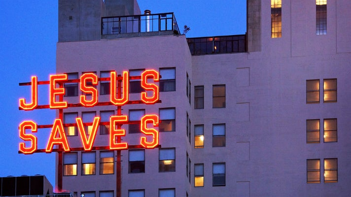 """Jesus Saves"" neon sign at the Ace Hotel Downtown Los Angeles"