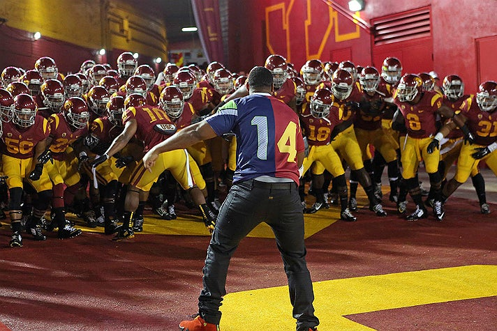 Malcolm Smith leads the USC Trojans out of the Player's Tunnel at the L.A. Coliseum