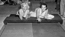 Marilyn Monroe and Jane Russell leave their handprints in the Forecourt of the Stars at the TCL Chinese Theatre